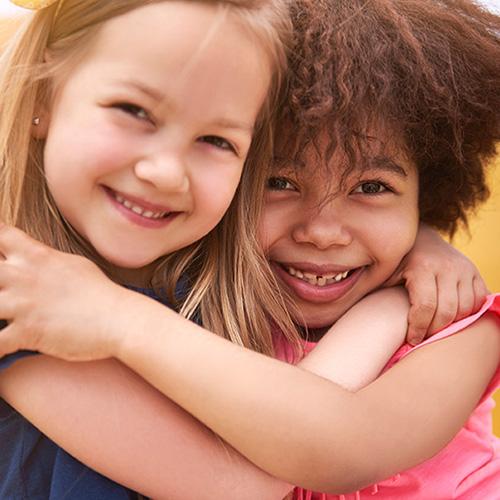 young girls hugging